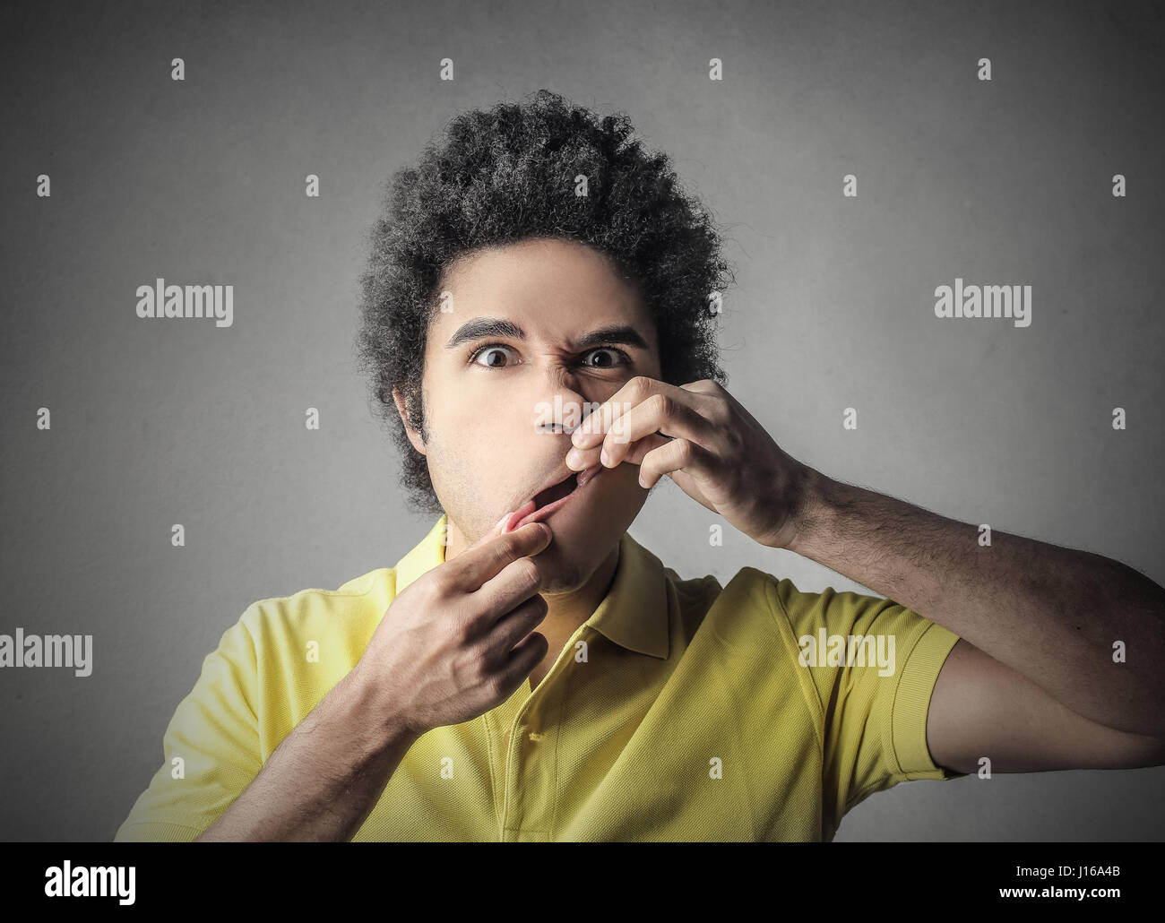 Young man making a grimace - Stock Image