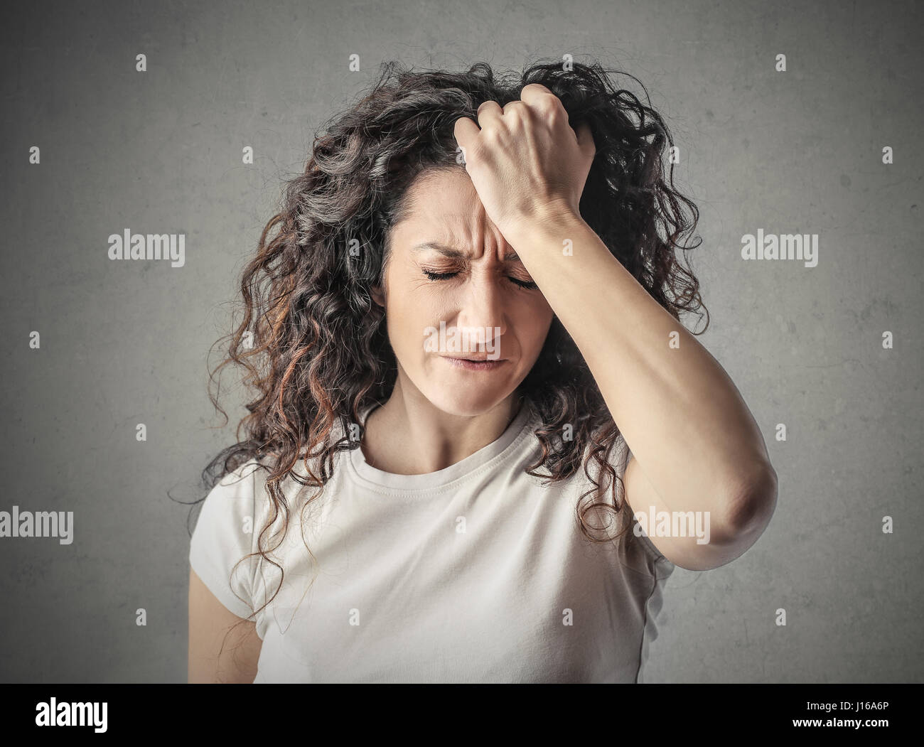 Brunette woman having a headache - Stock Image