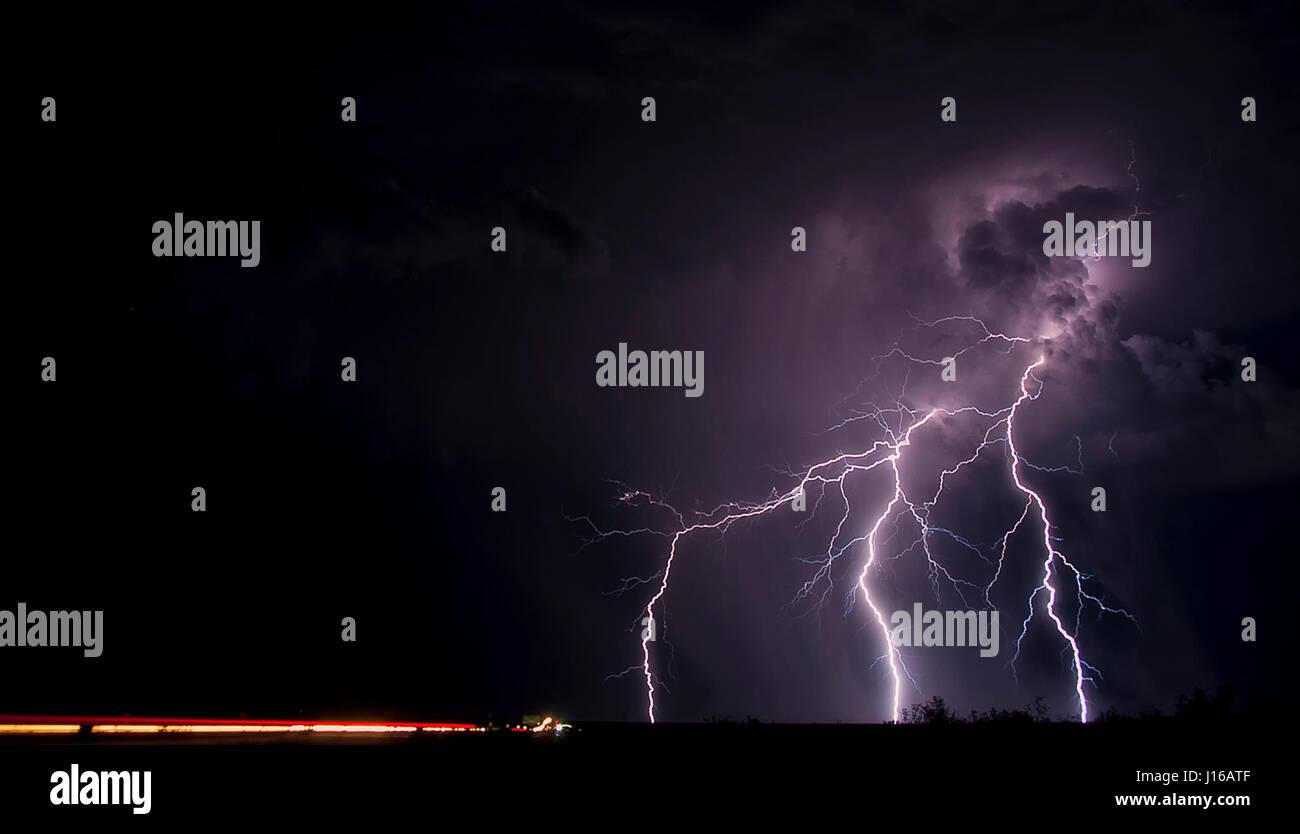 ARIZONA, USA: Lightning strikes over desert skyline. A TECHNICIAN'S hobby for storm chasing has led to these explosive Stock Photo