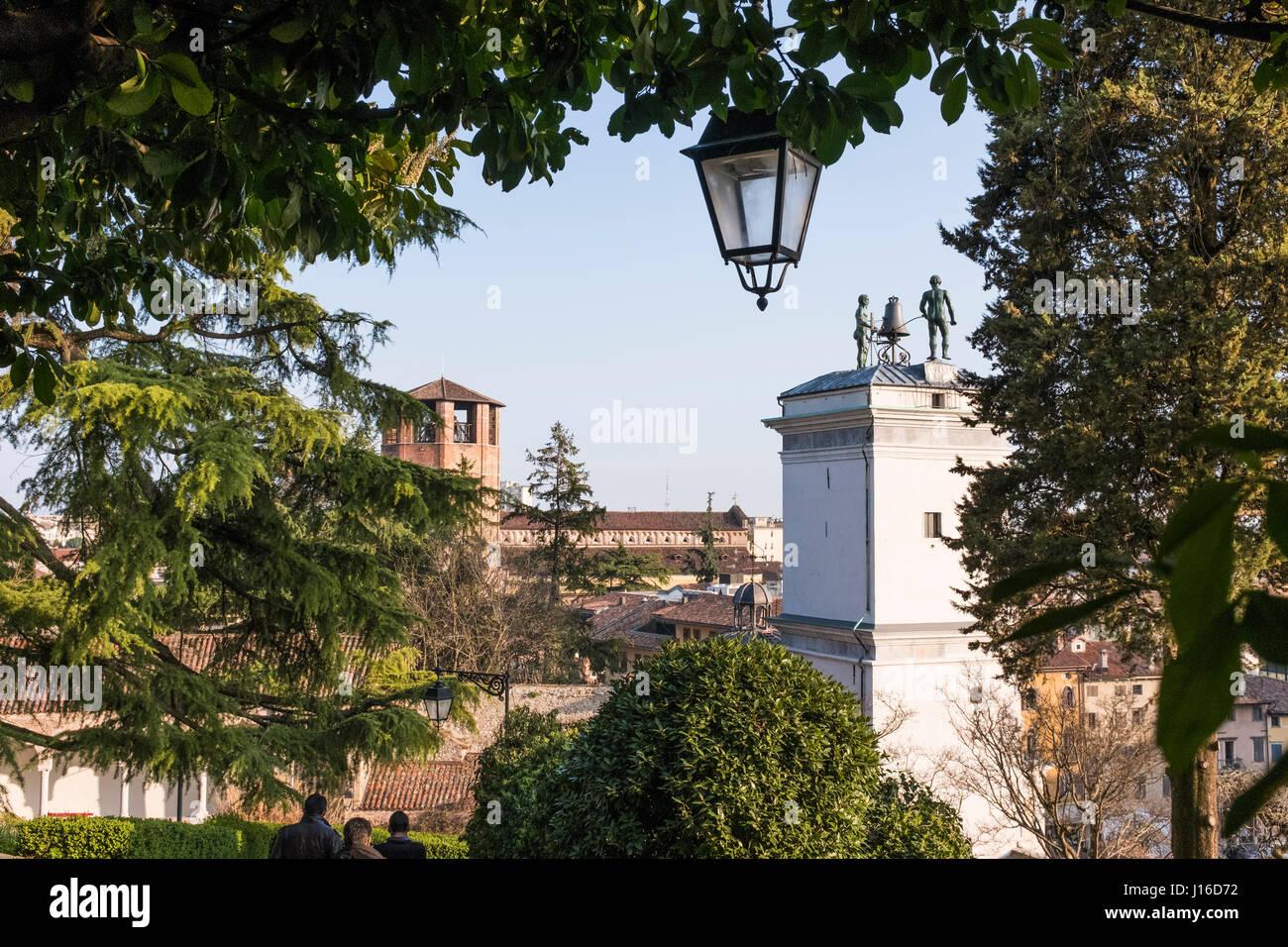Statues with clock on Loggia di San Giovanni in Udine, Italy - Stock Image