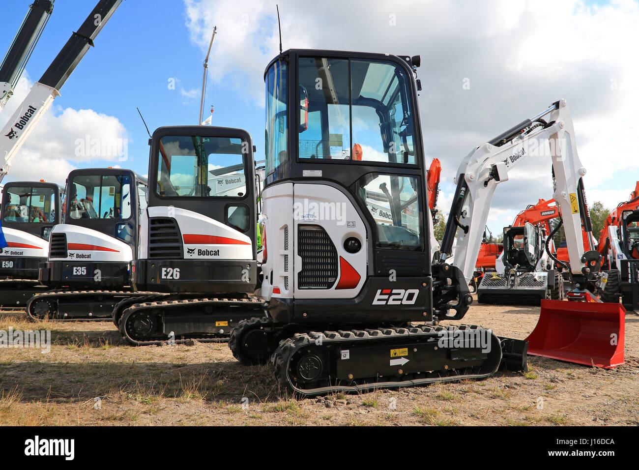 HYVINKAA, FINLAND - SEPTEMBER 11, 2015: Lineup of Bobcat compact excavators with E20 on the front on display at - Stock Image