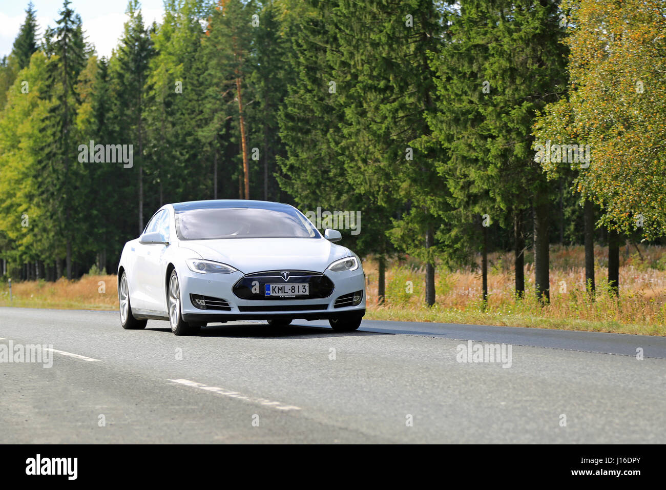 HUMPPILA, FINLAND - SEPTEMBER 12, 2015: Tesla Model S electric car on the road. Tesla's autopilot technology is - Stock Image