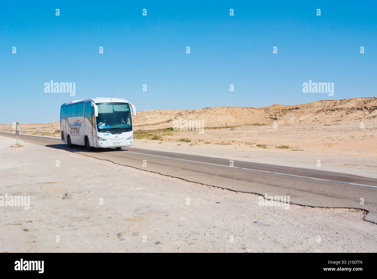 CTM bus, N1 road, between Boujdour and Dakhla, Western Sahara, administered by Morocco, Africa - Stock Image