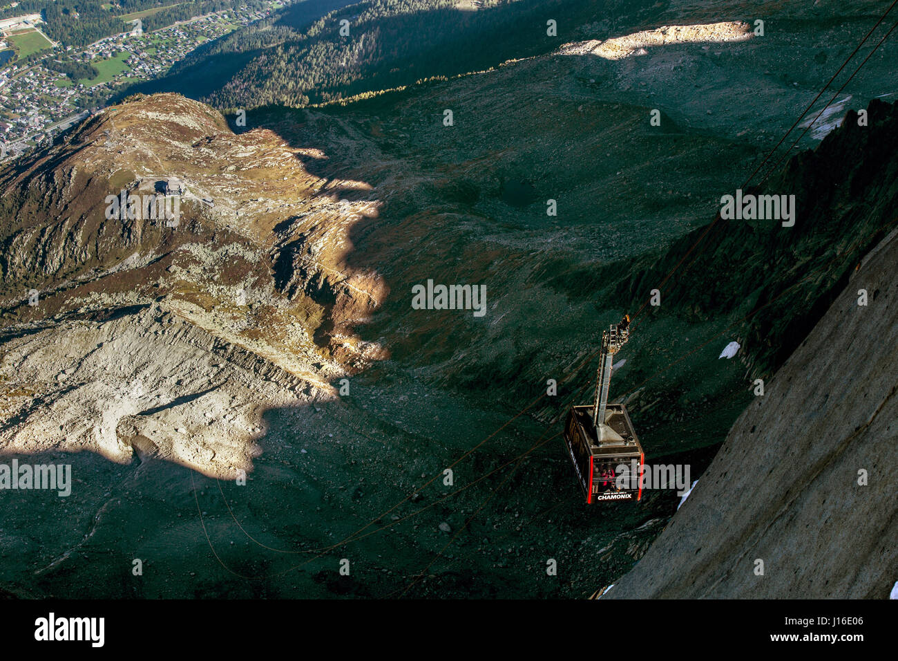 Famous Aiguille du Midi cable car between light and shadow - Stock Image