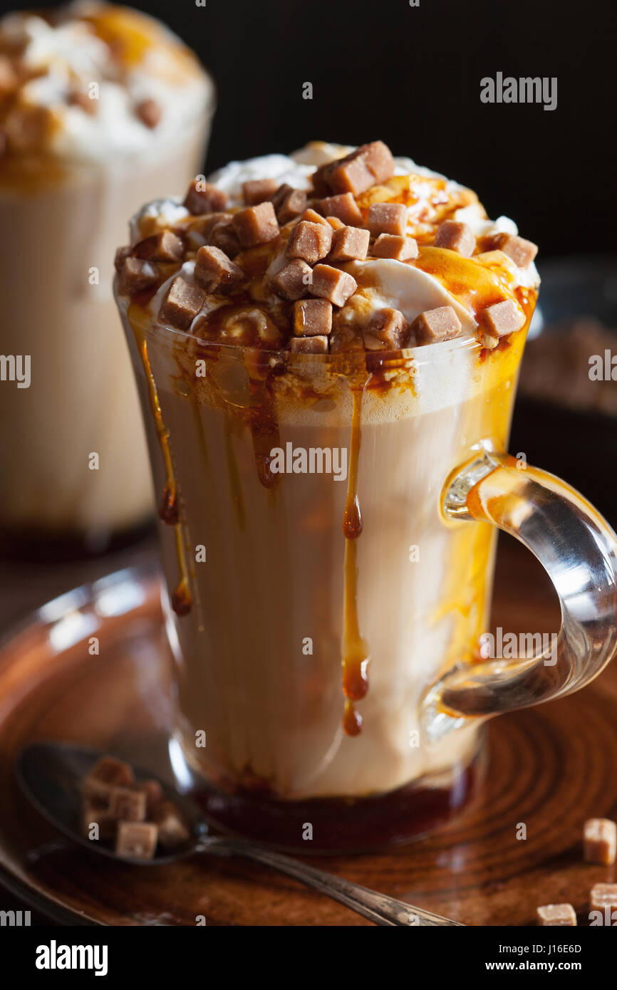 cafe latte with whipped cream and caramel - Stock Image