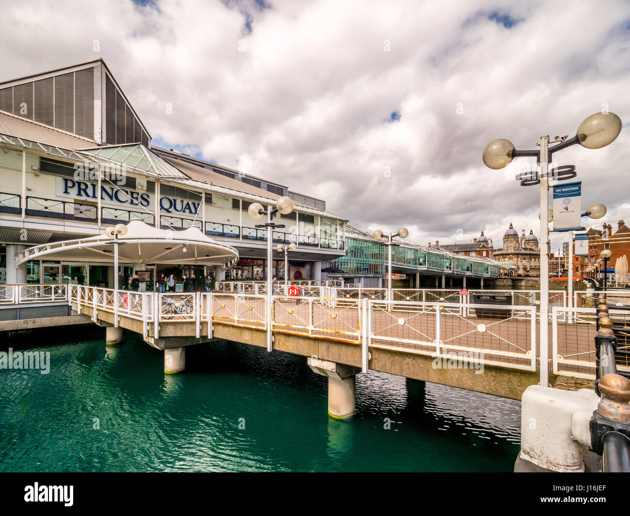 Prince's Quay shopping centre on stilts over the blue dyed water of Prince's dock, Hull, UK. - Stock Image