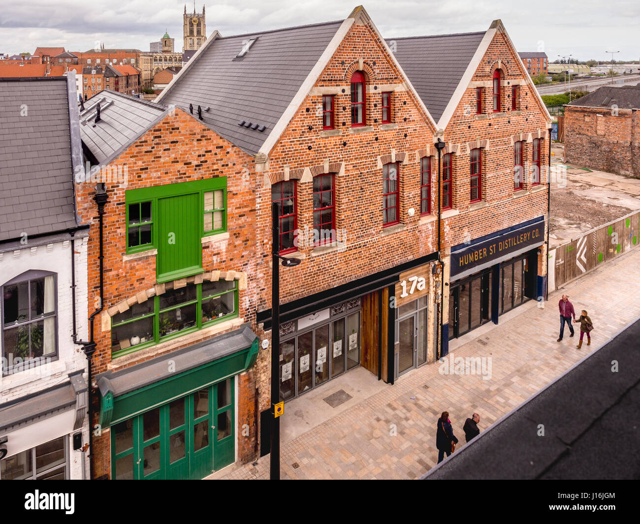 Humber Street, Fruit Market urban regeneration area in Hull dock area with Holy Trinity Church clock tower in distance, - Stock Image