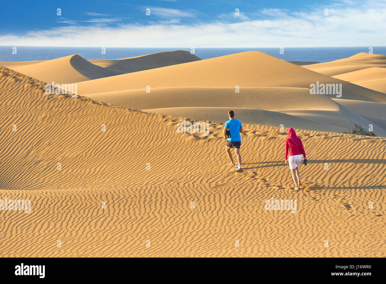 Tourists on the Maspalomas Sand Dunes National Park, Canary Islands, Gran Canaria, Spain - Stock Image