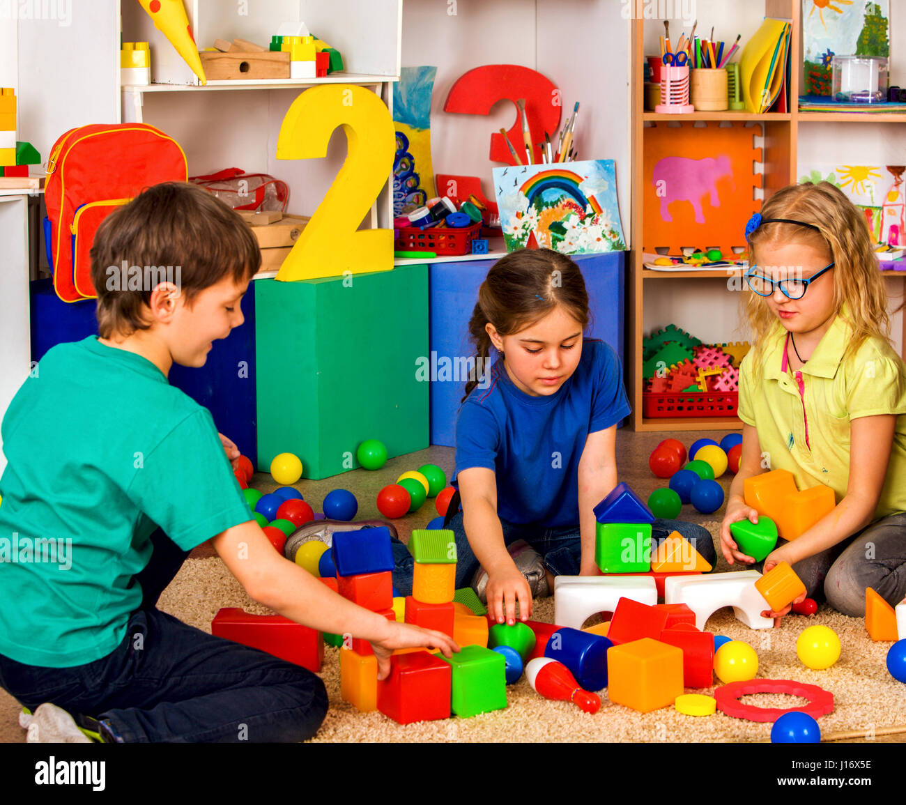 Children playing in kids cubes indoor. Lesson in primary school ...