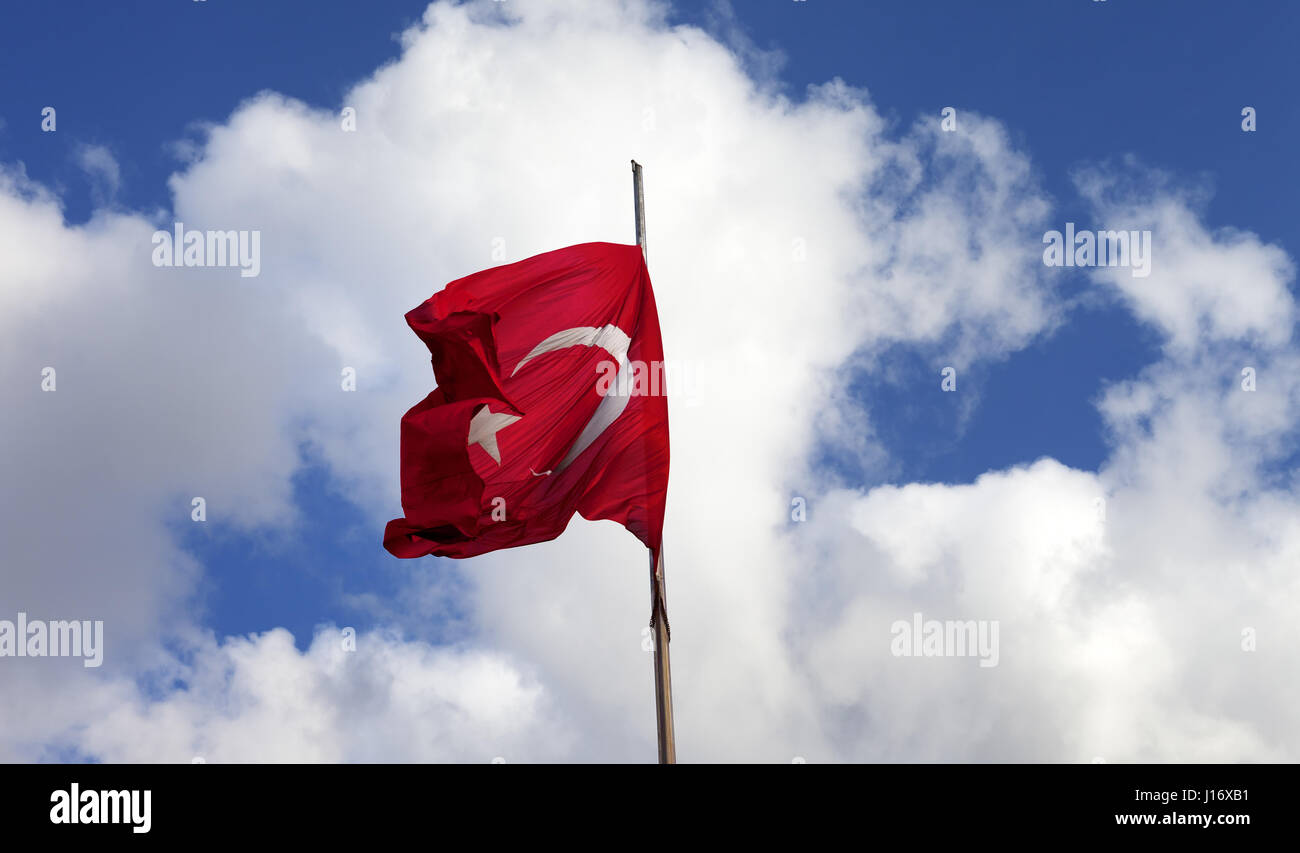 Turkish flag on flagpole waving in wind at sunny day - Stock Image