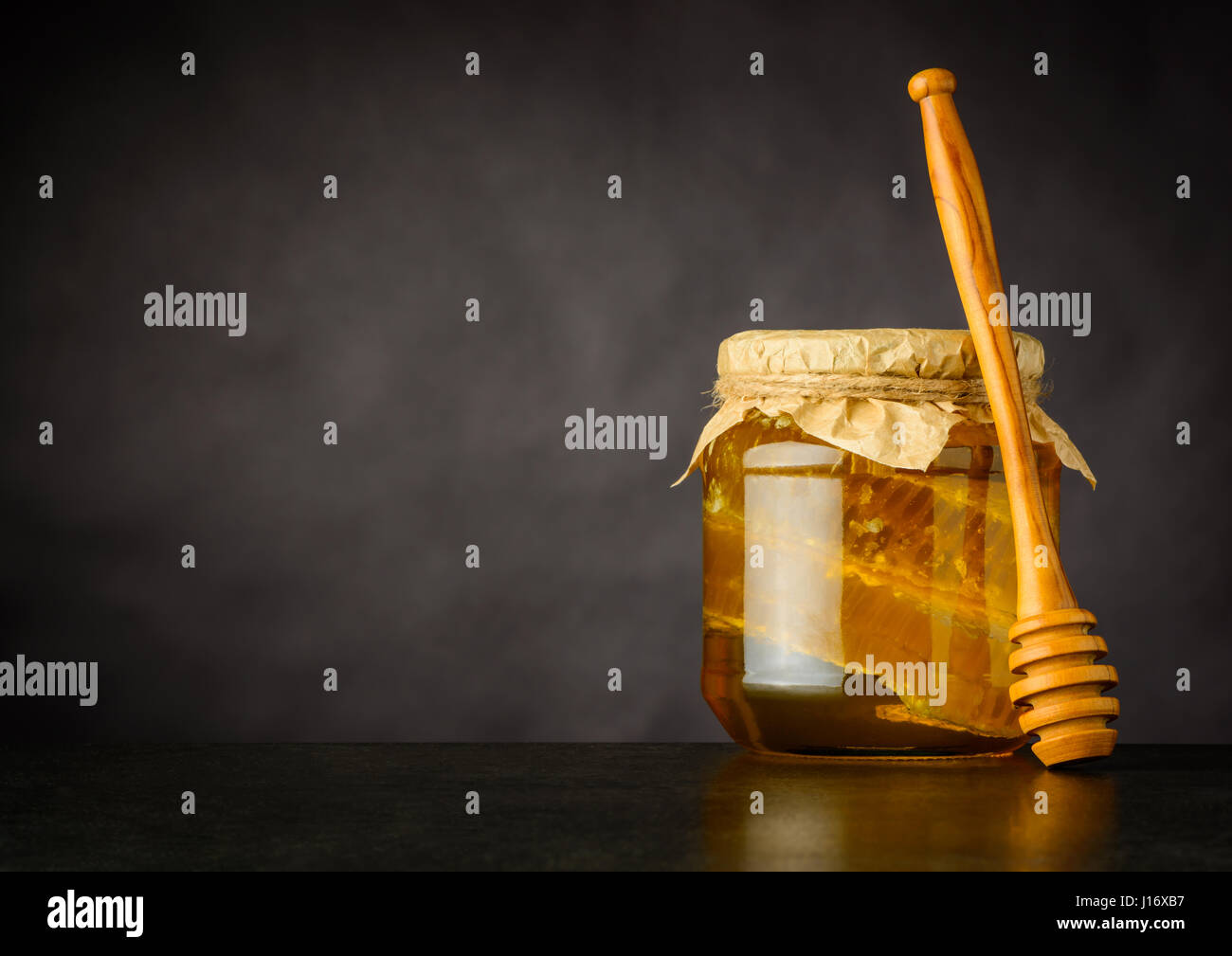 Honey Jar with Dripper, Comb and Copy Space - Stock Image