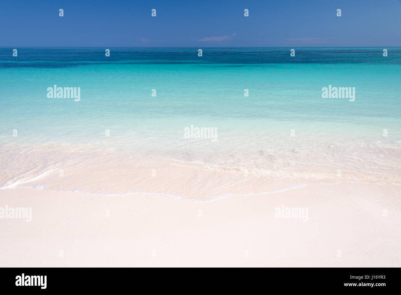 Sand and caribbean sea background - Stock Image