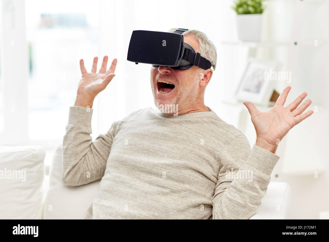 e471d57f459 old man in virtual reality headset or 3d glasses Stock Photo ...