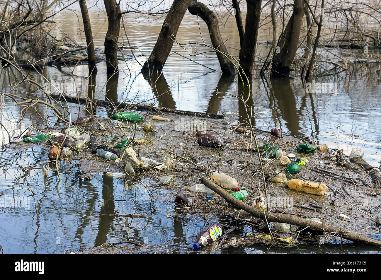 Spring flood leads to an ecological disaster - Stock Image