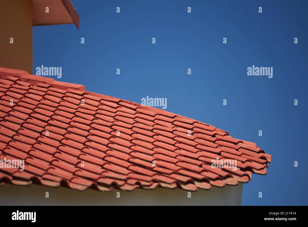 Red clay tiles for home roof with blue sky copy space Stock Photo ...