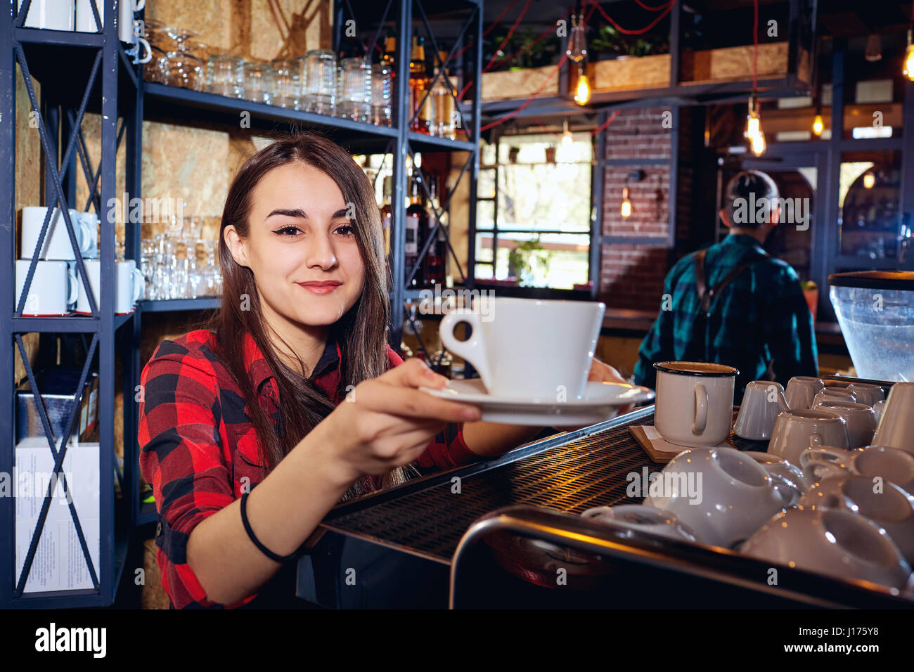 The barman girl works at bar in  restaurant - Stock Image