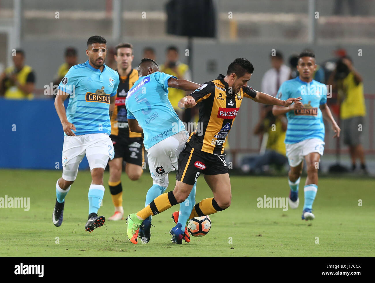 The Strongest's Rodrigo Ramallo (R) vies for the ball with Sporting Cristal's Pedro Aquino (L) during their - Stock Image