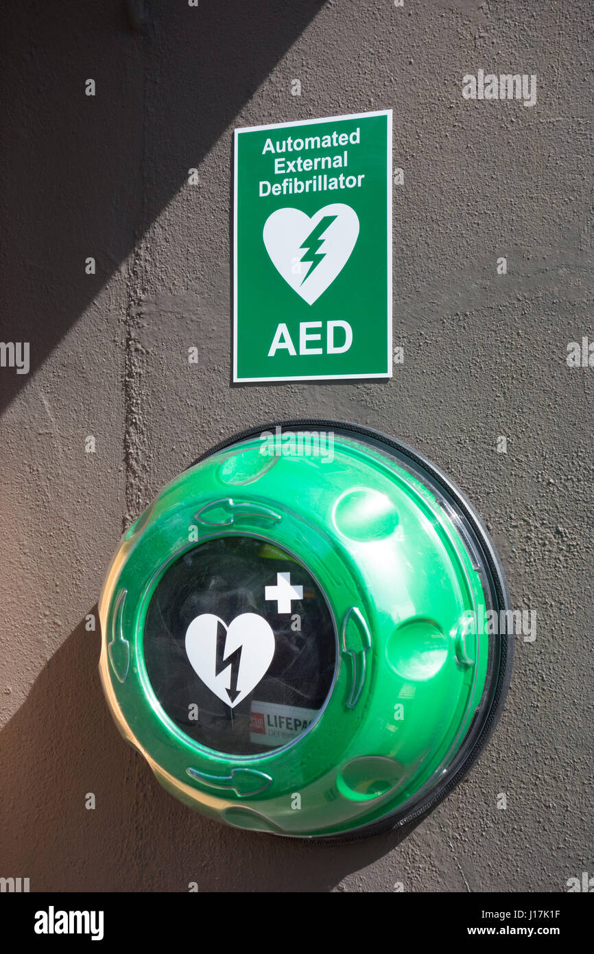 External Wall mounted defibrillator for public emergency heart first aid - Skerries, co. Dublin, Ireland - Stock Image