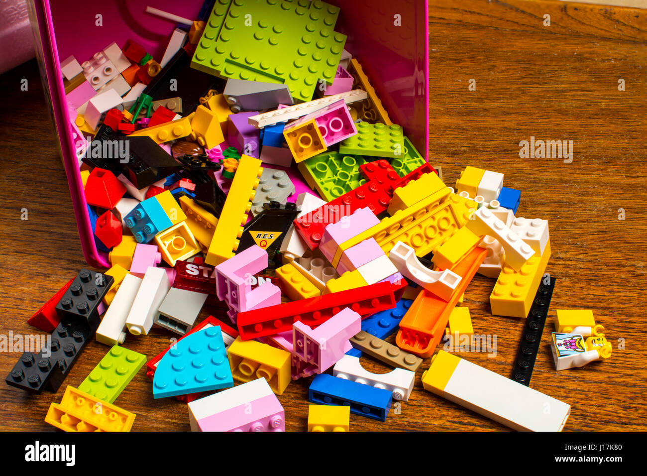 A scattering  of Lego bricks,blocks, bits and pieces falling out of a box Stock Photo