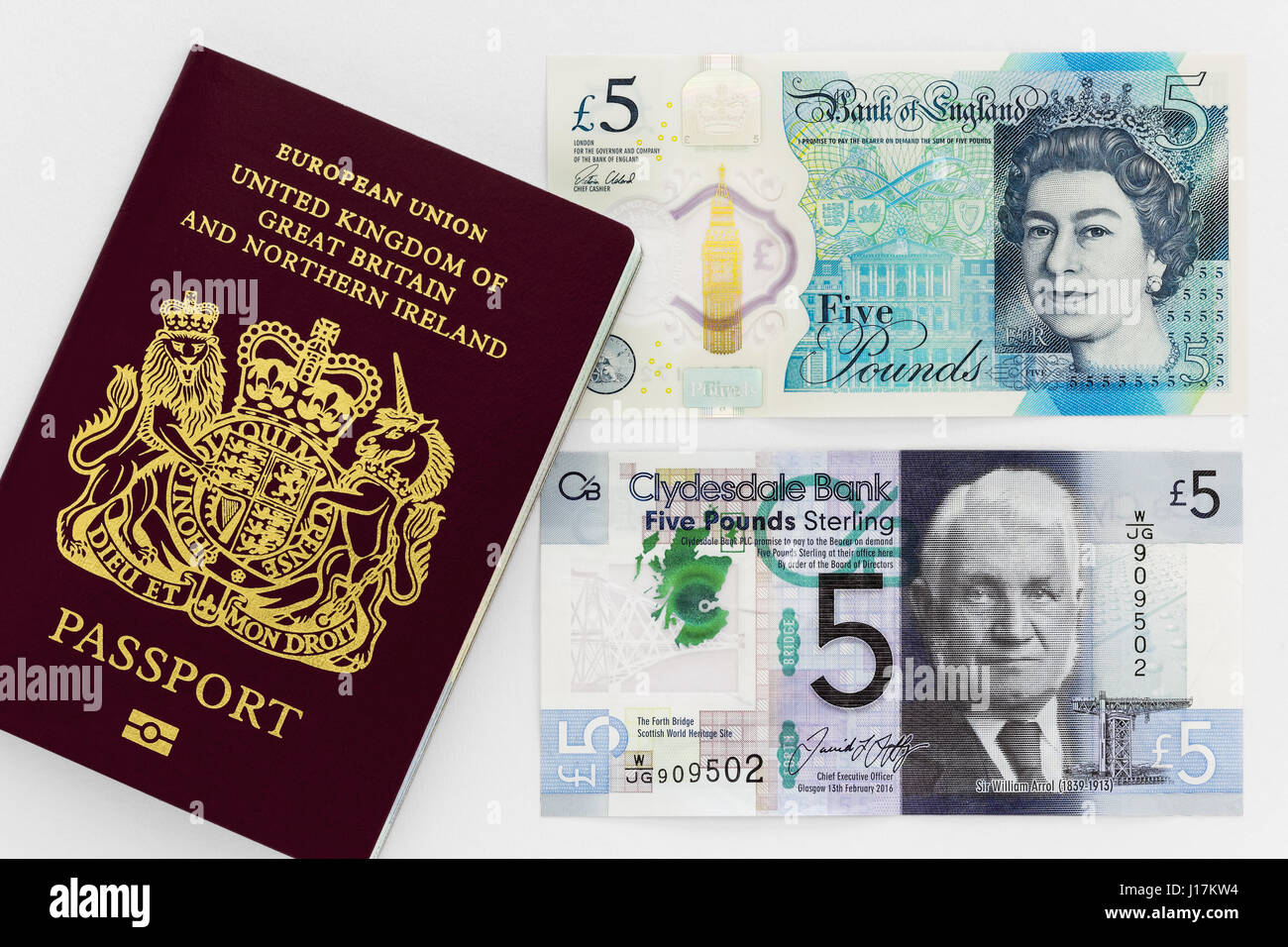 New Scottish and English five pound notes with passport of United Kingdom of Great Britain and Northern Ireland - Stock Image