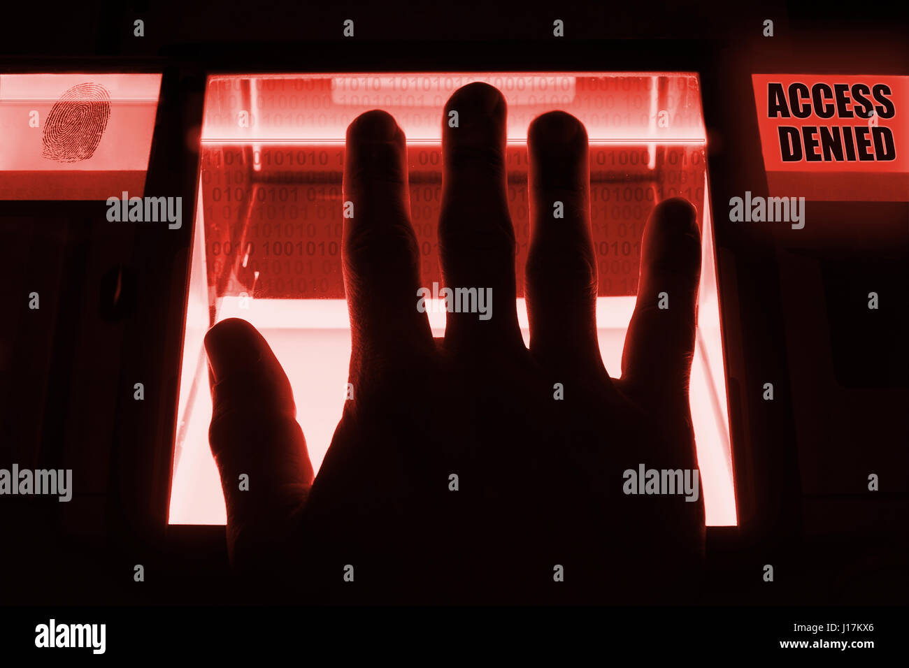 A person uses a fingerprint scanner., to unlock a computersystem. The system denies his entry - access denied. - Stock Image