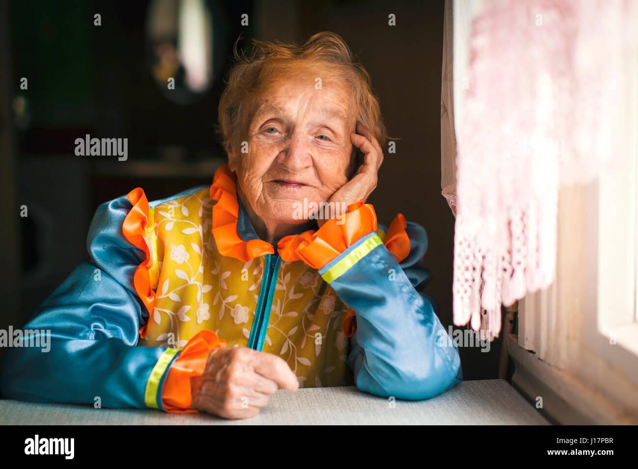 An elderly woman in Slavic ethnic clothing. - Stock Image