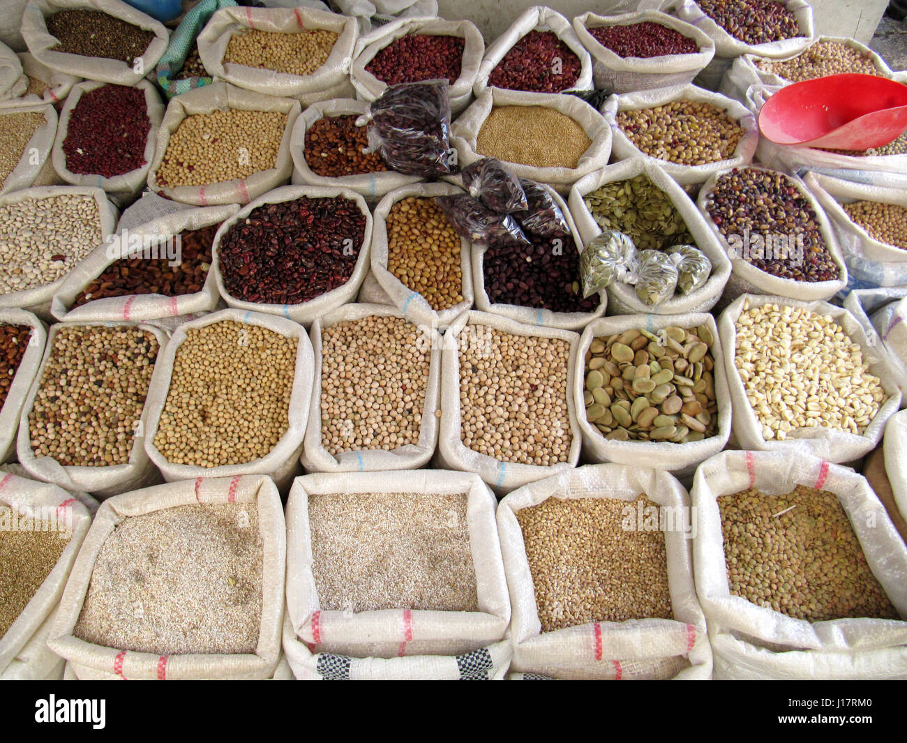 above view of sacks full of dry grains on sale in South American market - Stock Image
