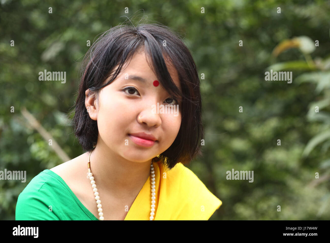 Portrait of Bodo girl. Nganglam, Bhutan - Stock Image