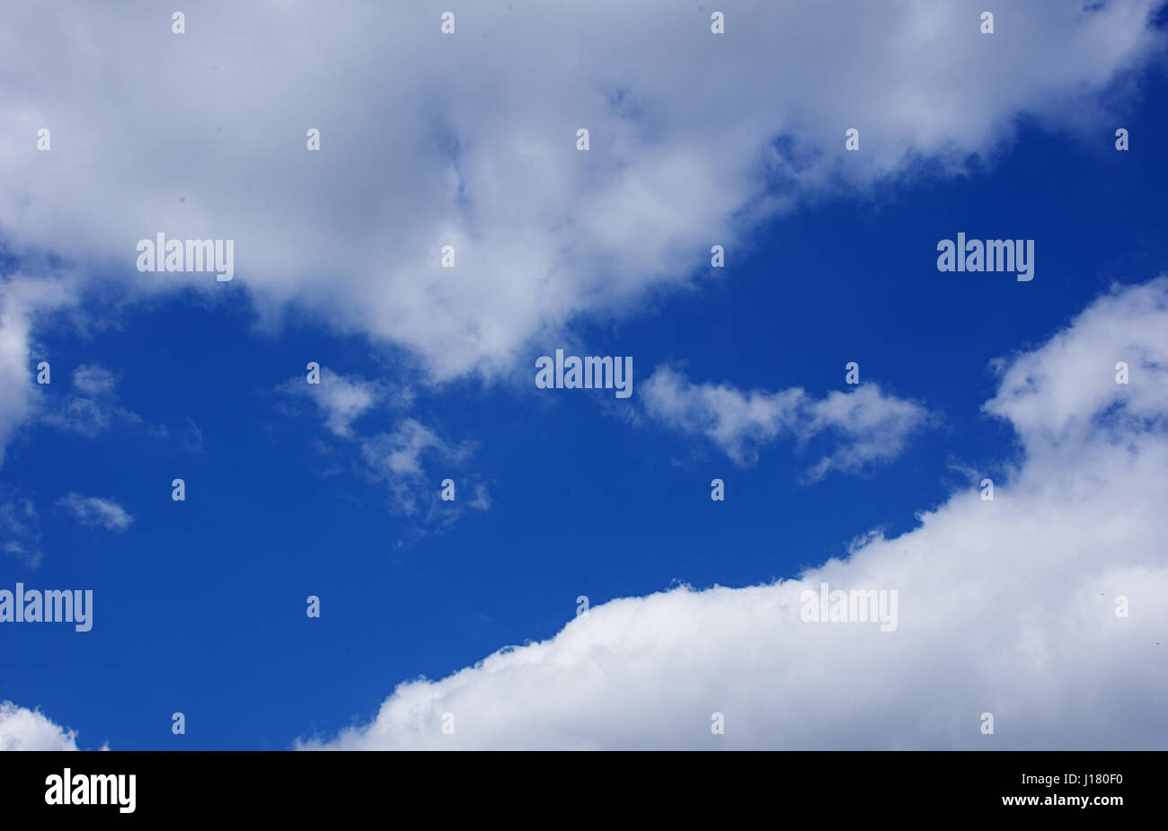 Blue sky with clouds. - Stock Image