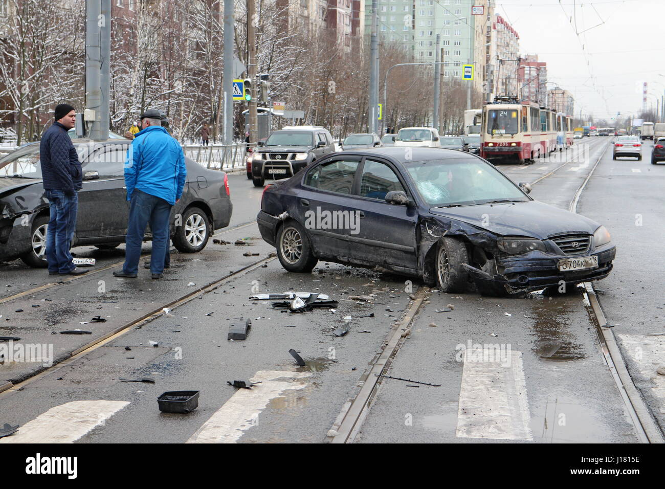 St. Petersburg, Russia, 14, April 2017  Accident two cars intersection, winter slippery road - Stock Image