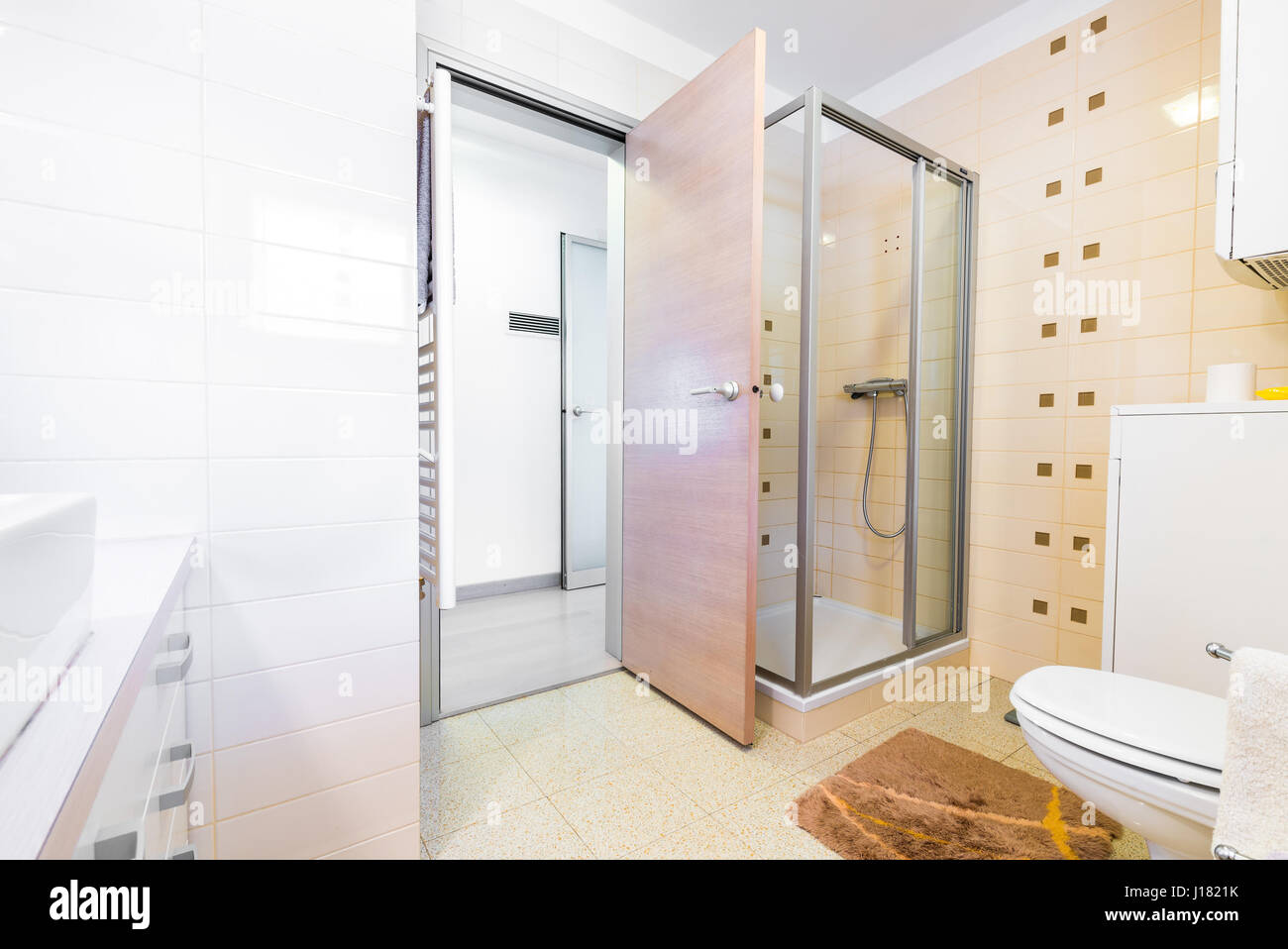 Modern small hotel bath with shower, sink and toilet. Cozy and fancy ...