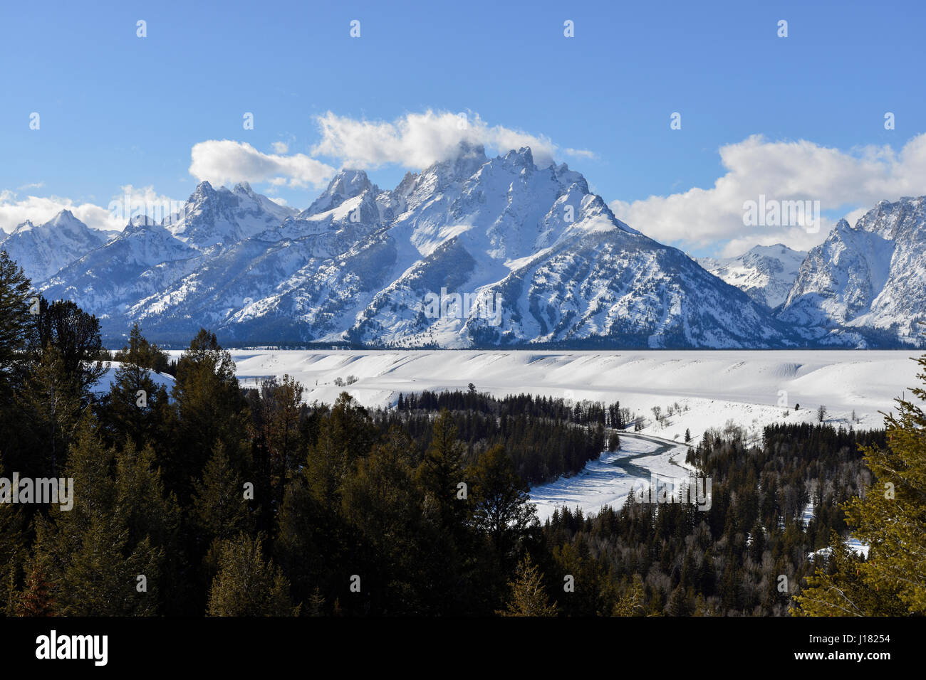 Snow covered Teton Range and Snake River on a nice winter day from Snake River Overlook, Grand Teton NP, Wyoming, - Stock Image