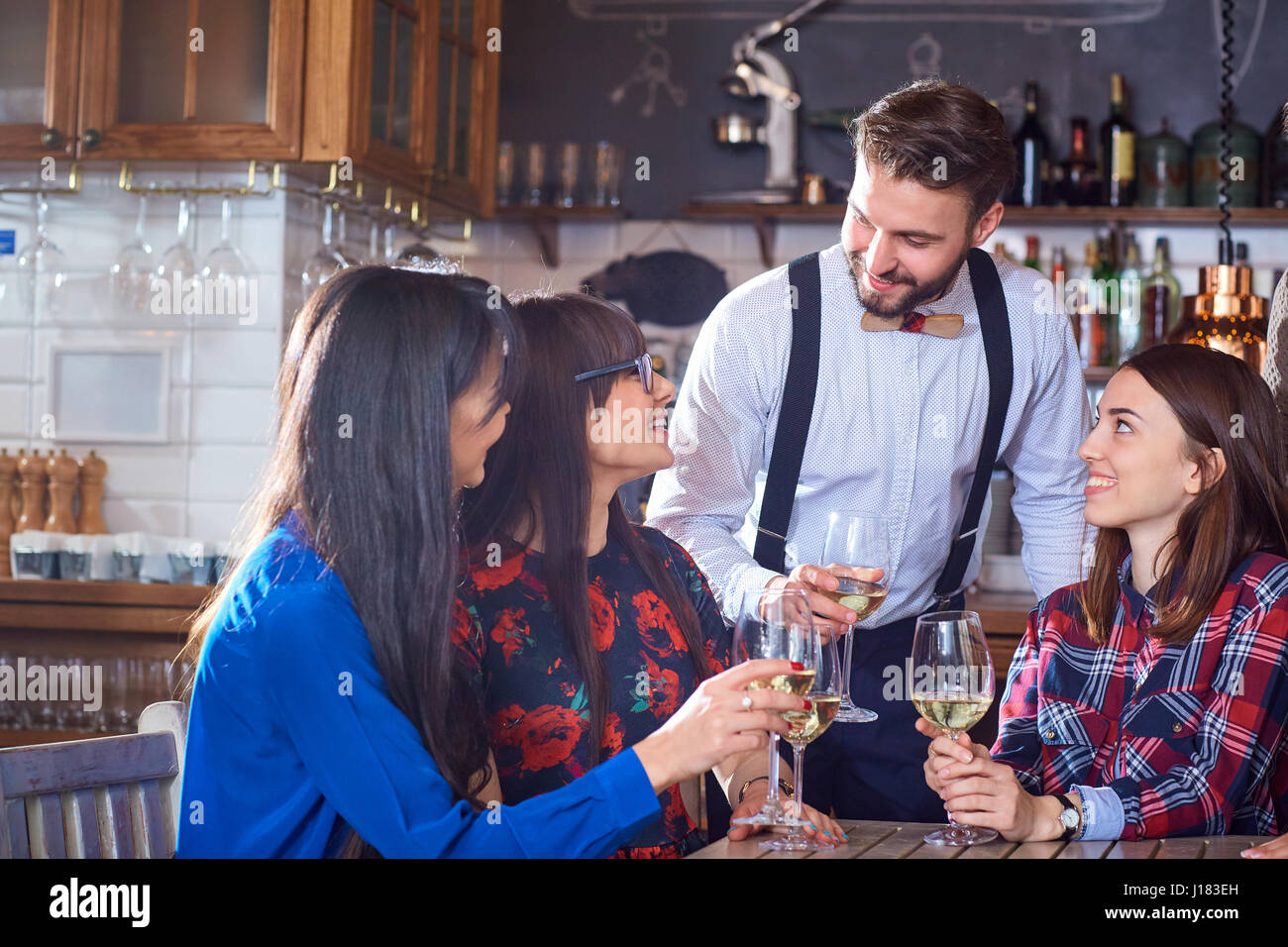 Group of friends are party having fun chatting with glasses of  Stock Photo