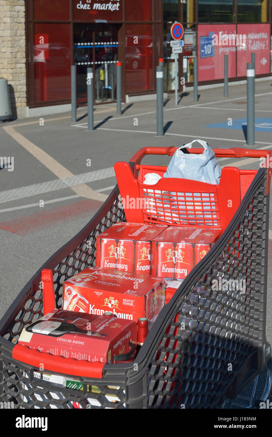 A french supermarket trolley full of beer and wine - Stock Image