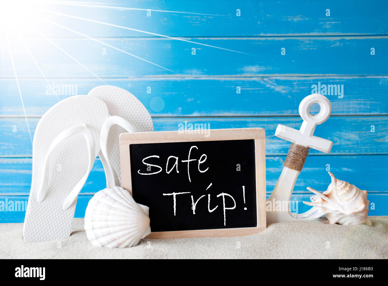 Chalkboard with english text safe trip blue wooden background chalkboard with english text safe trip blue wooden background sunny summer card with holiday greetings beach vacation symbolized by sand flip flop m4hsunfo