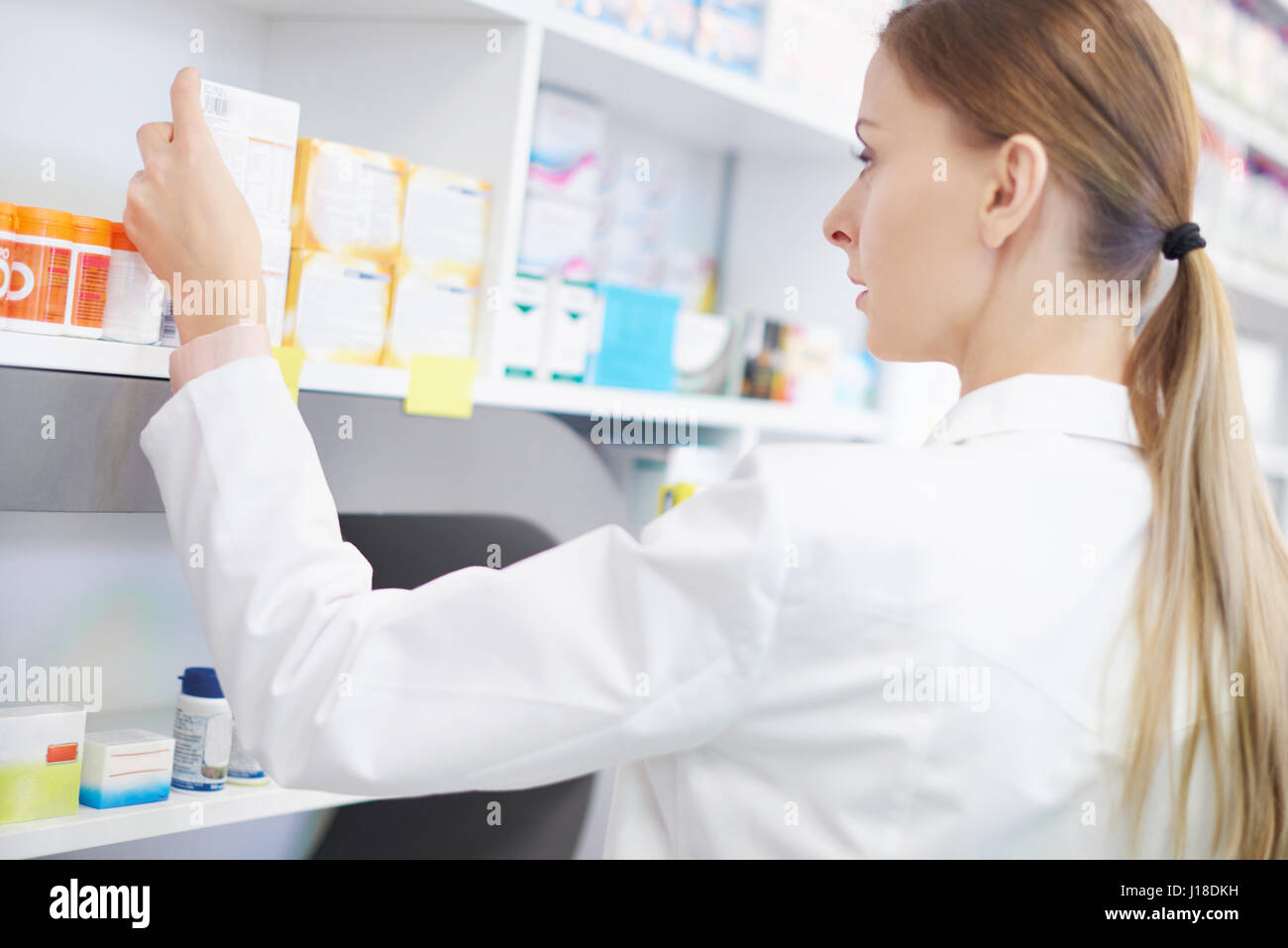 Female pharmacist doing inventory control - Stock Image