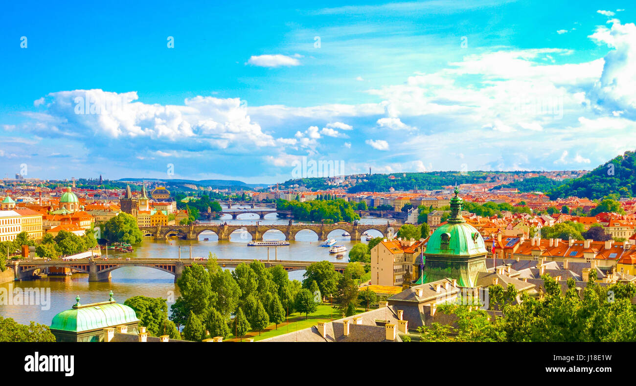 Panorama view of Prague skyline with Charles bridge and Vltava river in the late afternoon summer - Stock Image