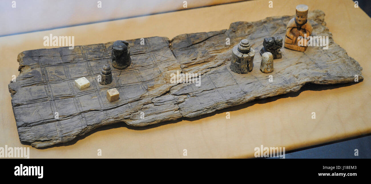Part of gaming board for 'hneftalfl', a game of siege already popular in the Viking Age. Chessmen of baked - Stock Image