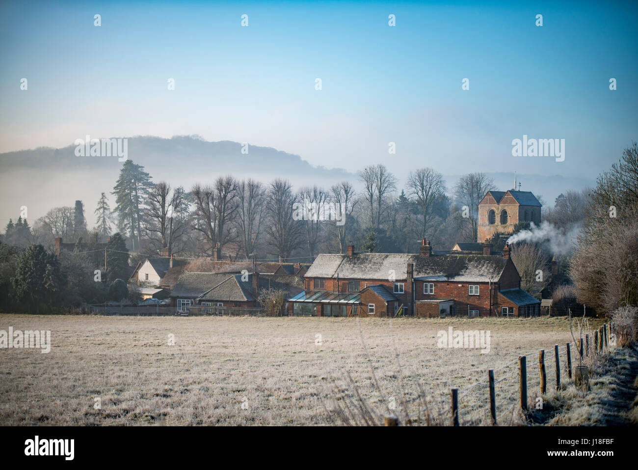 The village of Fingest from the East on a foggy, frosty, winter's morning, - Stock Image