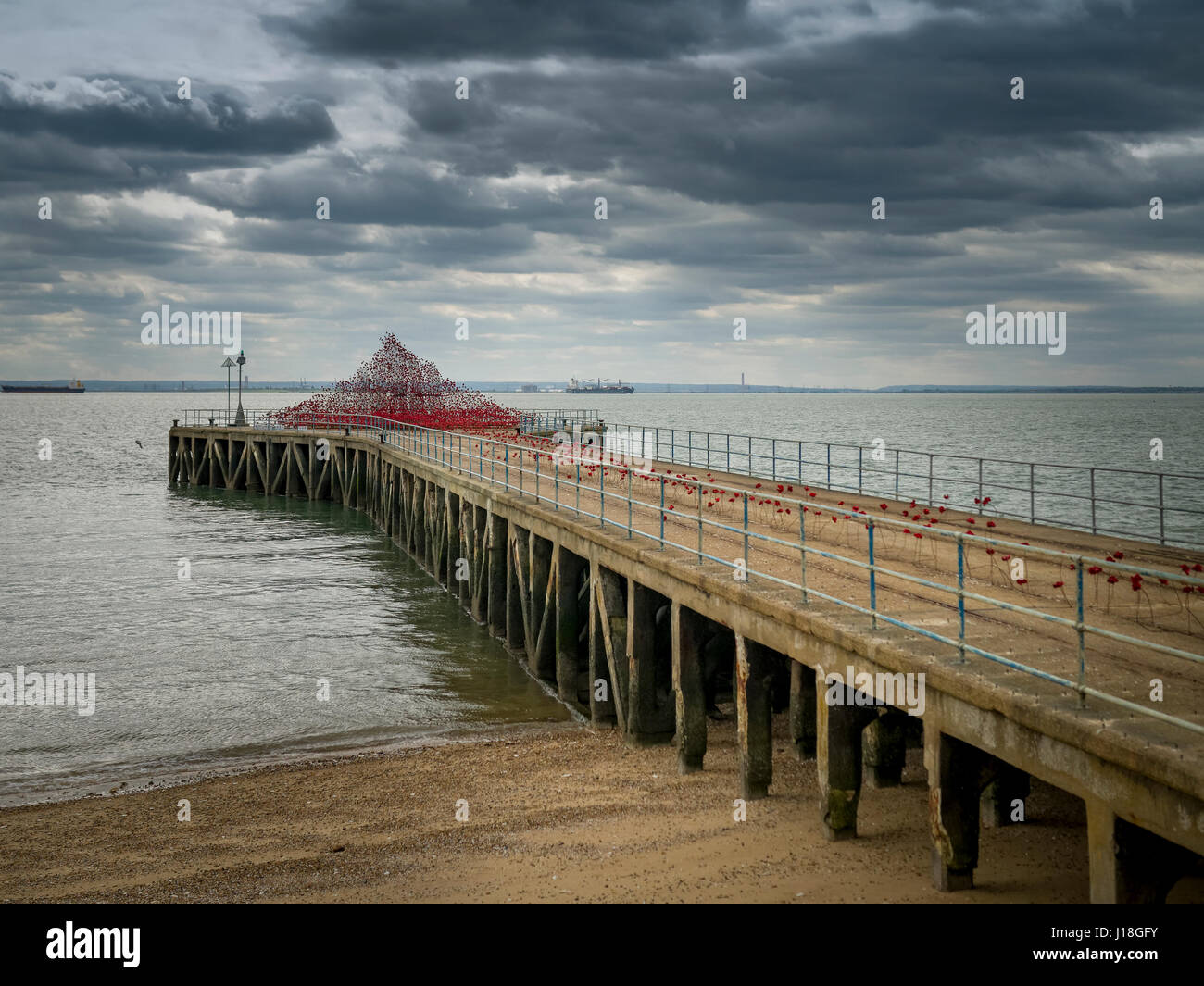 Poppies Wave is an art installation by artist Paul Cummins on display at Barge Pier in Gunners Park, Shoeburyness, - Stock Image