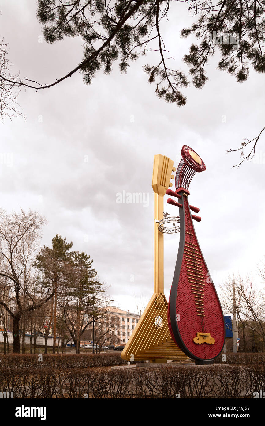 Khabarovsk, Russia: Giant traditional stringed musical instruments - balalaika and pipa lute - metal sculpture tourist - Stock Image