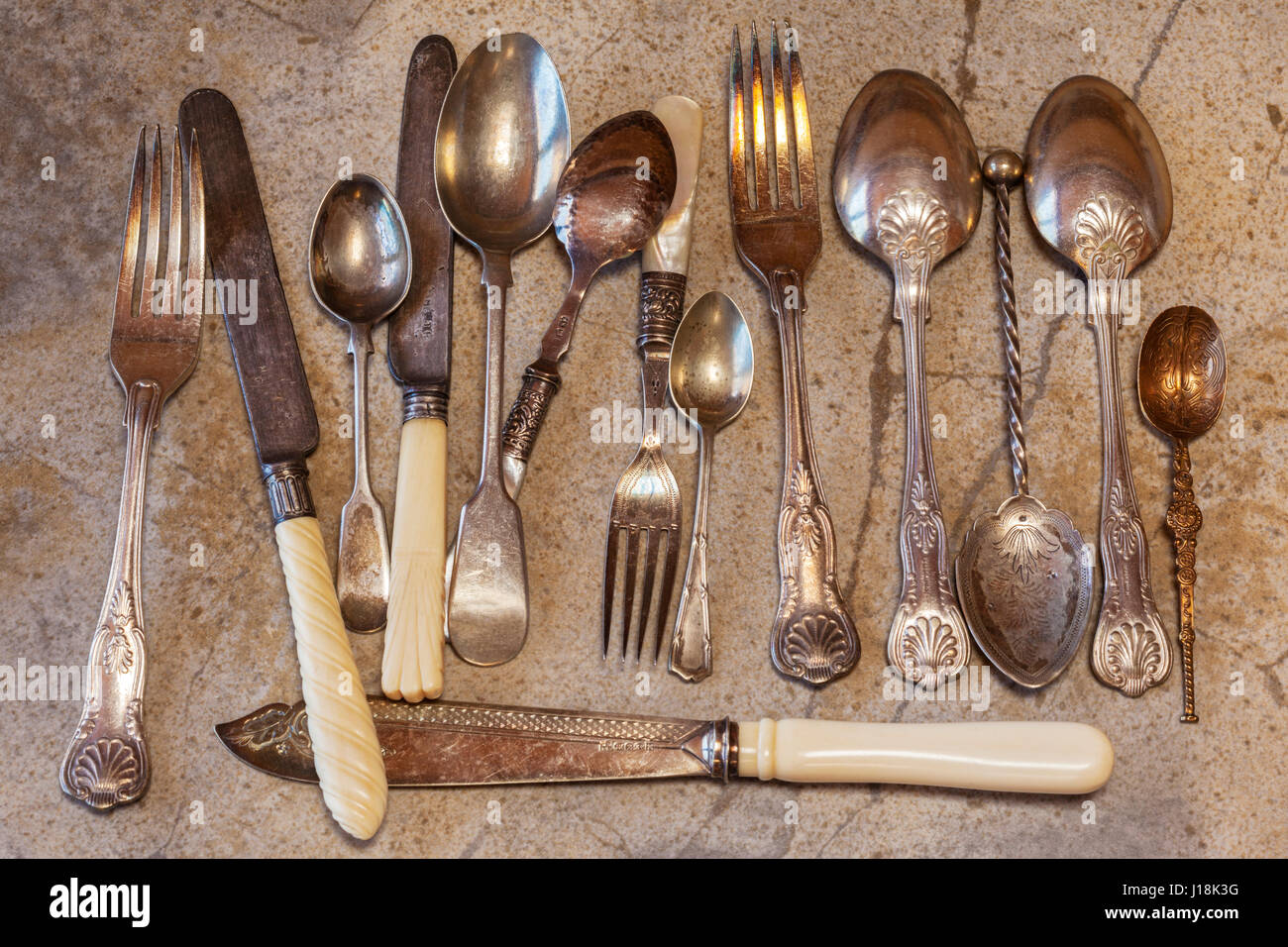 A collection of old cutlery - Stock Image