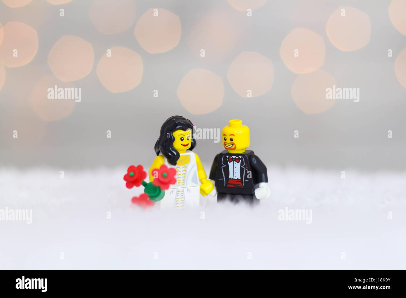 Male and female lego couple dressed up for their wedding - Stock Image