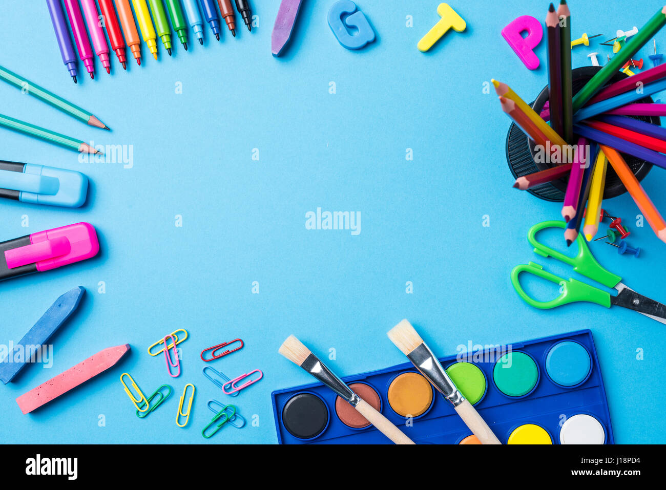 Overhead shot of school supplies on blue background Stock ...