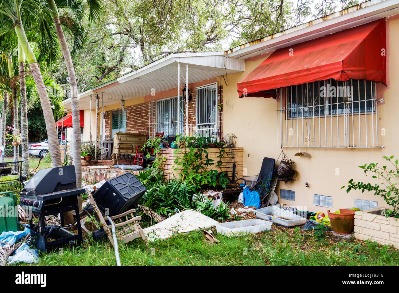 Miami Florida Little Havana House Yard Trash Neglected Exterior Dirty  Awning Junk Window Security Bars