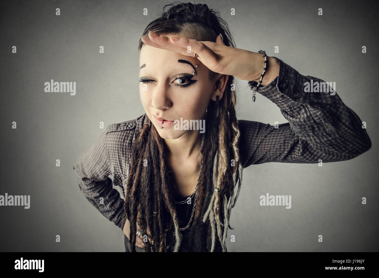 Alternative woman looking at the distance - Stock Image