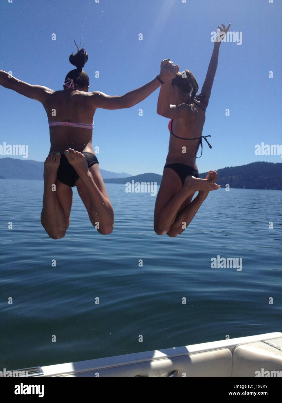 We love Summer!. Family fun on vacation in Sandpoint, Idaho. Lake Pend d'Orielle. We love to jump off of the - Stock Image