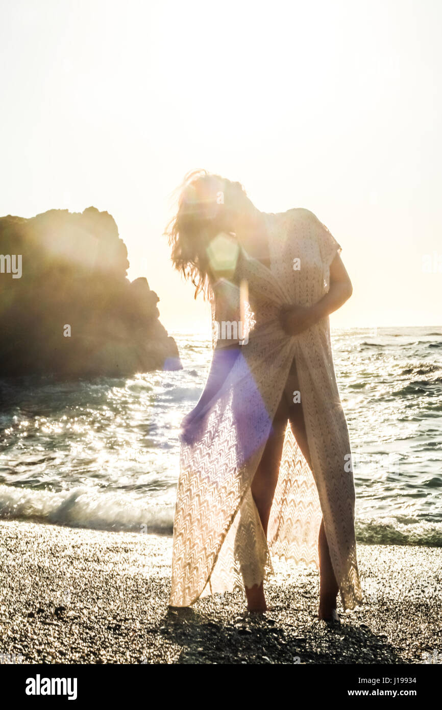 Brighting the beach. Part of a photo session with model Jeanna Halstead for my beachwear collection. Stock Photo