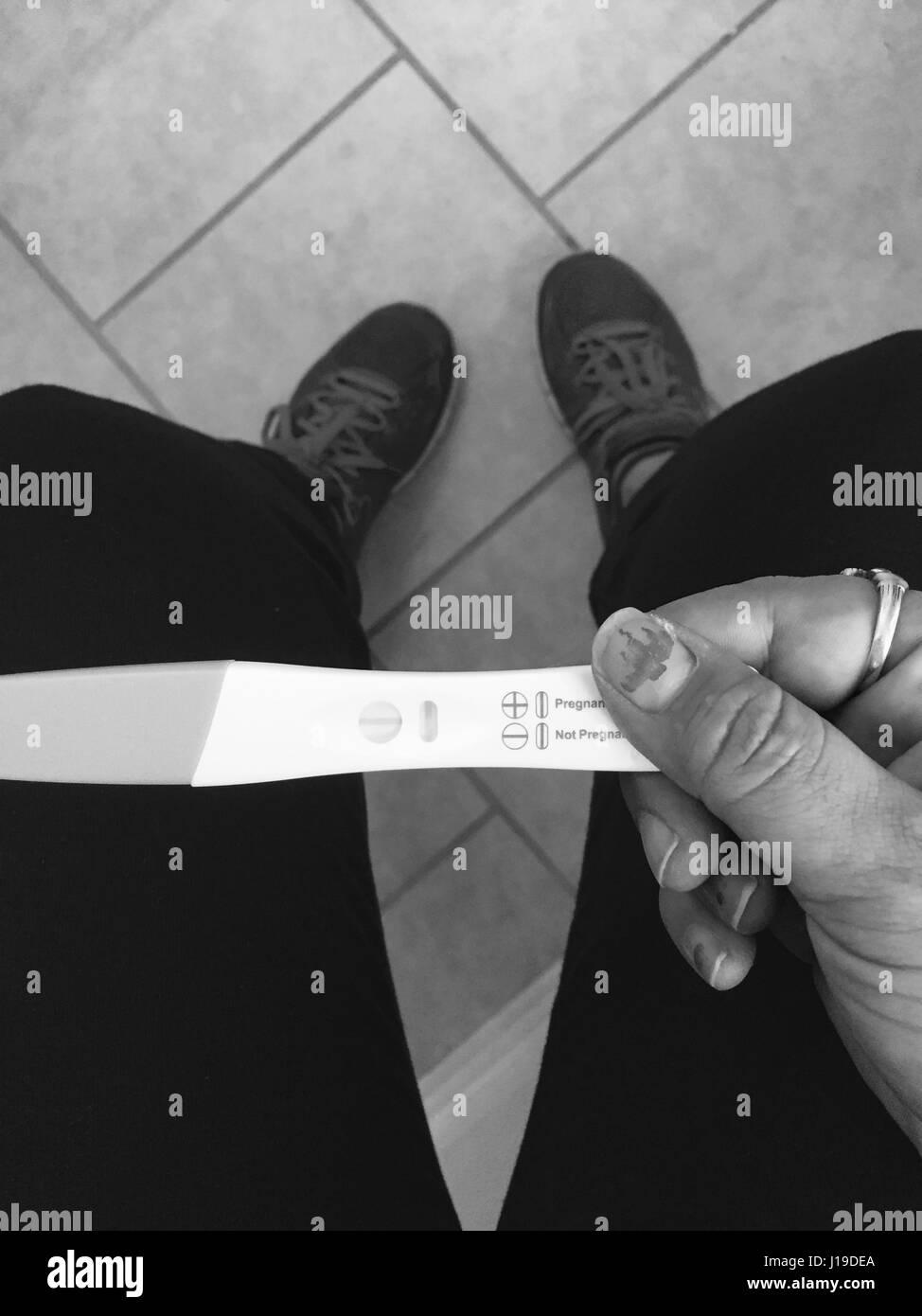 pregnancy test positive black hand