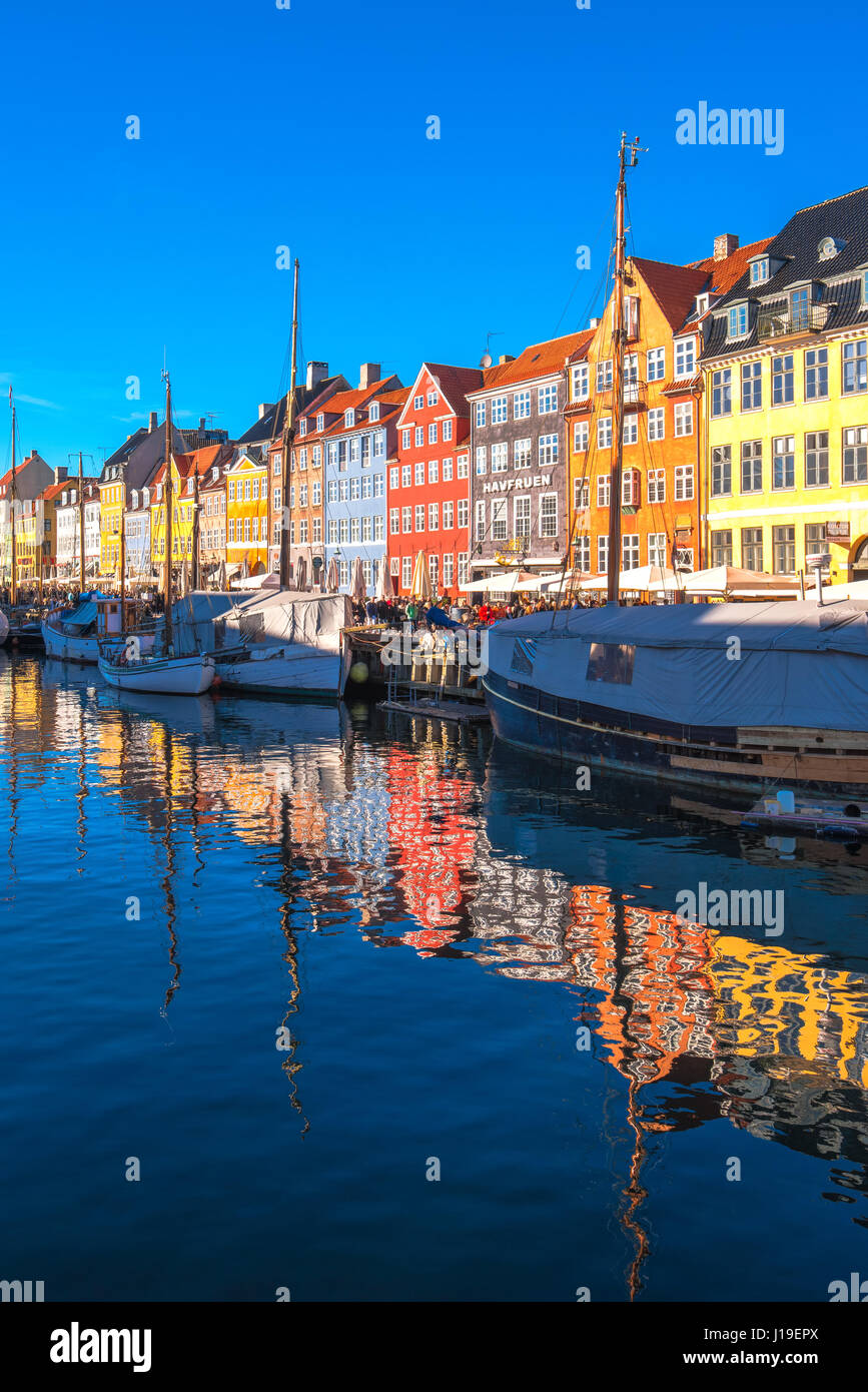 COPENHAGEN, DENMARK - MARCH 11, 2017: Copenhagen Nyhavn district. Nyhavn was constructed by King Christian V from Stock Photo
